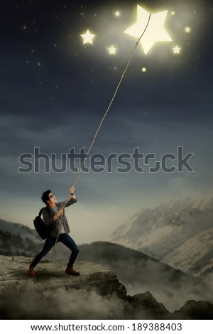 Concept of young student getting his ambition - stock photo