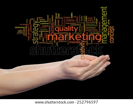 Concept or conceptual abstract word cloud or wordcloud in man or woman hand on black background, metaphor to  business, trend, media, focus, market, value, product, advertising, customer or  corporate - stock photo