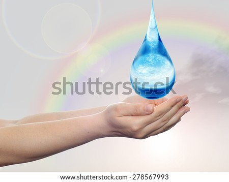 Concept or conceptual blue water or liquid drop falling in two woman hands on rainbow sky background for splashing, palm, clear, purity, freshness, nature, clean, health, rain, environment, drinks - stock photo