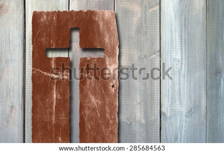 Concept or conceptual Christian cross cut in an old grungy or vintage paper, over a wood texture background for religion, retro, aged, grunge, faith, holiday, God, religious, Jesus or belief designs - stock photo