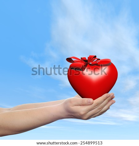 Concept or conceptual 3D red abstract heart sign or symbol with ribbon held in hands by a man, woman or child on blue sky background, metaphor for love, holiday, gift, care, valentine or romantic - stock photo