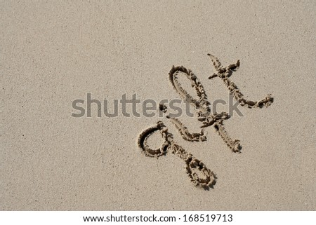 Concept or conceptual hand made or handwritten gift text in sand on a beach in an exotic island - stock photo