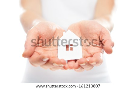 concept. paper figurine house in the hands - stock photo