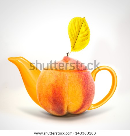Concept peach teapot - stock photo