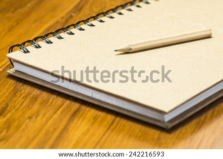 Concept pencil on notebook. - stock photo