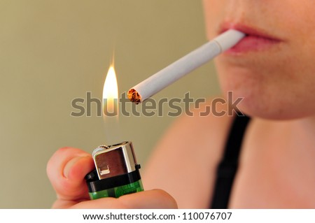 Concept photo of a woman smoking a cigarette. - stock photo