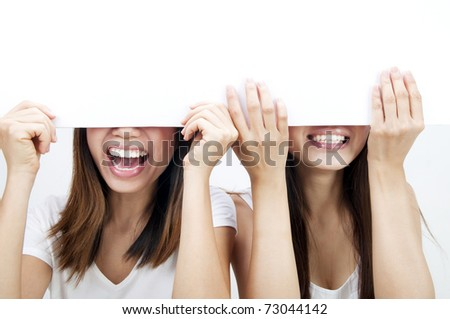 Concept photo of Asian women holding a white card, covering eyes. - stock photo