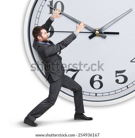 concept photo of emotional businessman trying to stop a time  - stock photo