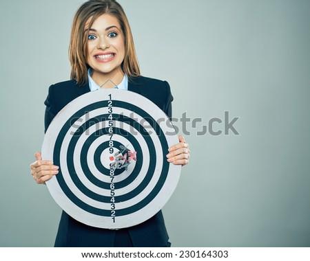 Concept portrait of young business woman holding target. Studio portrait. - stock photo
