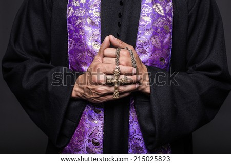 Concept: prayer.  Studio shot on black background    - stock photo