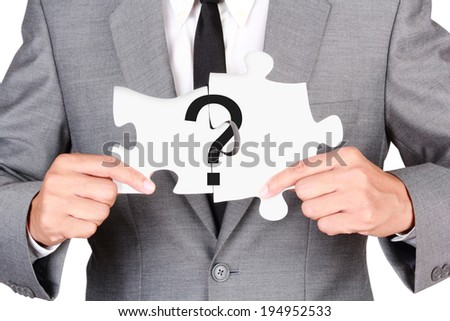 Concept question mark jigsaw connected businessman showing jigsaw connect create people connection teamwork concept isolated on white - stock photo