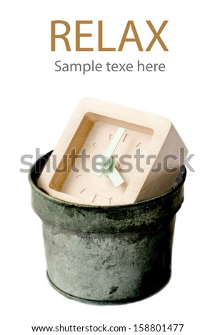 Concept relax - Wood Clock in metal trash bin. - stock photo