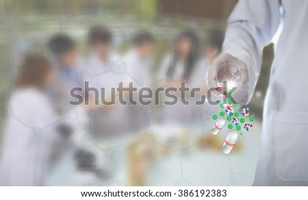 Concept: Scientists test the to research DNA ,  background blurred images researchers to work  - stock photo