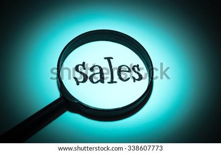 Concept search loupe magnifier sales button - stock photo