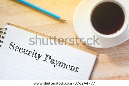 Concept Security Payment message on book. A pencil and a glass coffee table.Vintage tone. - stock photo
