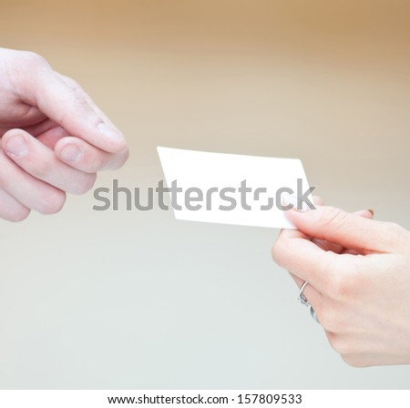 Concept shot of exchange business card between man and  woman. Partnership - stock photo
