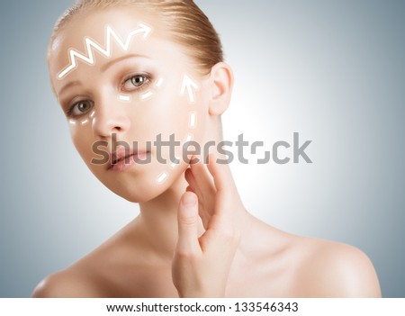 concept skincare. Skin of beauty young woman with facelift, plastic surgery, rejuvenation, arrows - stock photo