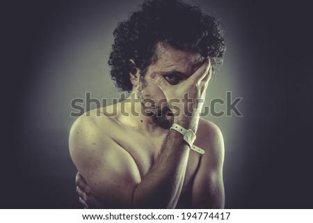 Concept sorrow, Nude Man with hospital bracelet. - stock photo