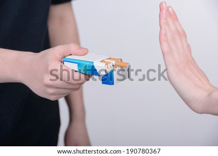 Concept: stop smoking, isolated on gray background - stock photo