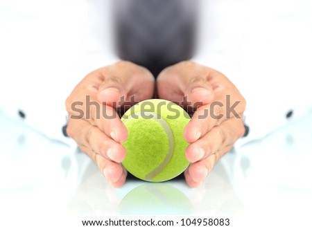 Concept, Tennis ball in hands - stock photo
