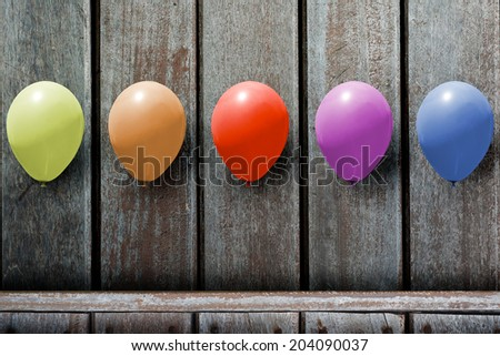 Concept,  text boxes colorful balloons,  on a wooden floor. - stock photo