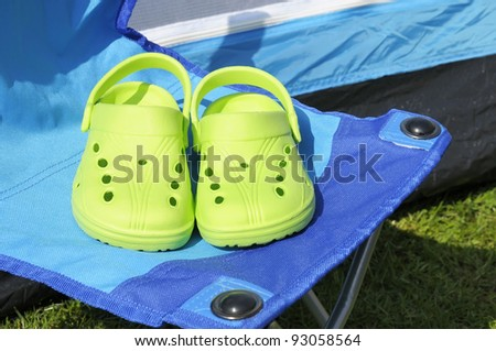 Concept to illustrate a reduction in carbon footprint by going on camping holidays. - stock photo