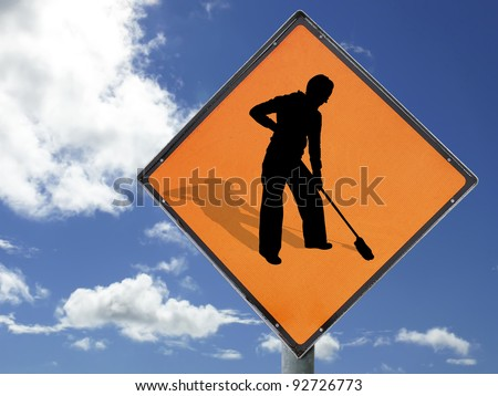 Concept to illustrate 'Women at work'. Humourous play on the 'Men at work' sign isolated with clipping path(s) against a blue sky. - stock photo