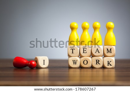 Concept toy pawn figures: There is no I in teamwork. - stock photo