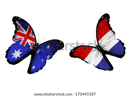 Concept - two butterflies with Australia and Netherlands flags flying, like two football teams playing - stock photo