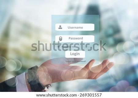 Concept web site creation, businessman holding login interface - stock photo
