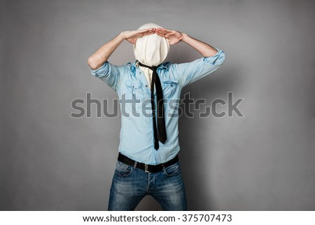 concept with a young man with face covered by a textile material  - stock photo