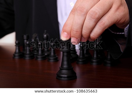 concept with businessman playing chess - stock photo