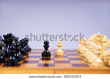 Concept with chess pieces on a wooden chess board. Selective focus - stock photo