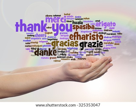 Conceptual abstract thank you word cloud held in hands in different languages or multilingual for education, Thanksgiving Day, appreciation, multicultural, friendship, tourism travel over rainbow sky - stock photo