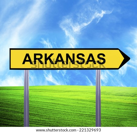 Conceptual arrow sign against beautiful landscape with text - ARKANSAS - stock photo