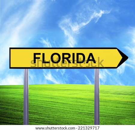 Conceptual arrow sign against beautiful landscape with text - FLORIDA - stock photo