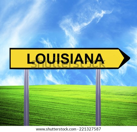 Conceptual arrow sign against beautiful landscape with text - LOUISIANA - stock photo