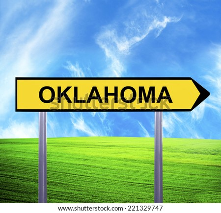 Conceptual arrow sign against beautiful landscape with text - OKLAHOMA - stock photo