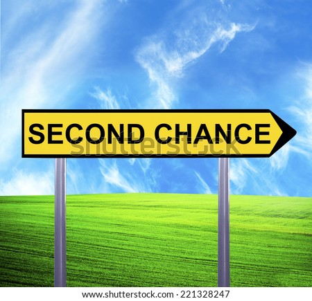 Conceptual arrow sign against beautiful landscape with text - SECOND CHANCE - stock photo