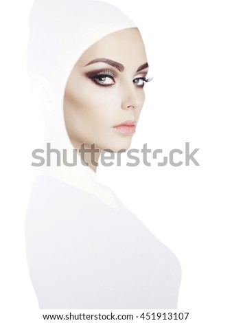 Conceptual art fashion studio photo of beautiful young woman with perfect makeup  - stock photo