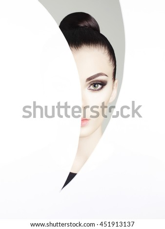 Conceptual art fashion studio photo of beautiful young woman with perfect makeup  - stock photo