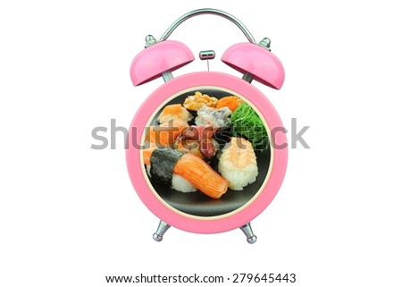 conceptual art : sushi time : sushi within pink alarm clock isolated on white background - stock photo