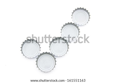Conceptual check mark image made of used beer caps over white background - stock photo