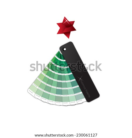 Conceptual Christmas Card: a Christmas tree made by a green colors palette, with a red origami star on the top, isolated - stock photo