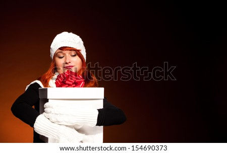 Conceptual christmas photo of red hair woman with christmas box - stock photo