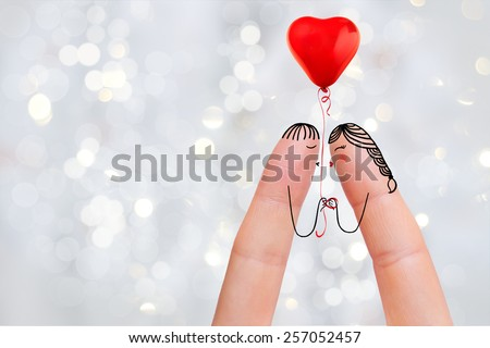 Conceptual finger art. Lovers are holding balloon. Stock Image Happy Valentine's Day, wedding, 8 March, womans day, spring and birthday creative and funny love series. Painted fingers in love concept - stock photo