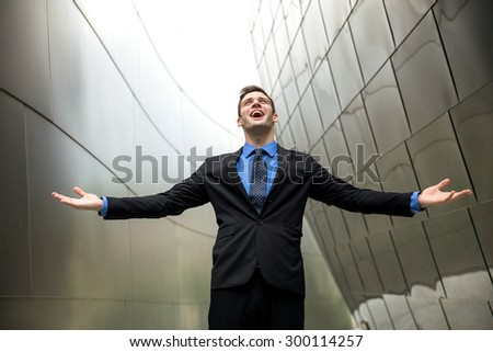 Conceptual freedom wealth success power happiness in a suit tie with urban architecture background - stock photo