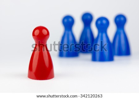 Conceptual game pawns that depict the concept different - stock photo