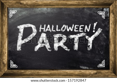 Conceptual Halloween Party ad on black chalkboard. - stock photo
