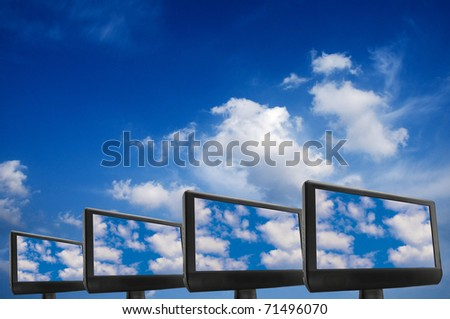 conceptual image for cloud computing, with monitors displaying clouds on screen - stock photo